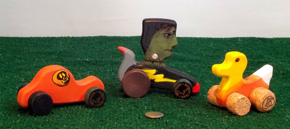 Little wooden cork cars, ducks and Frankenstein's for Halloween. Made with recycled corks.