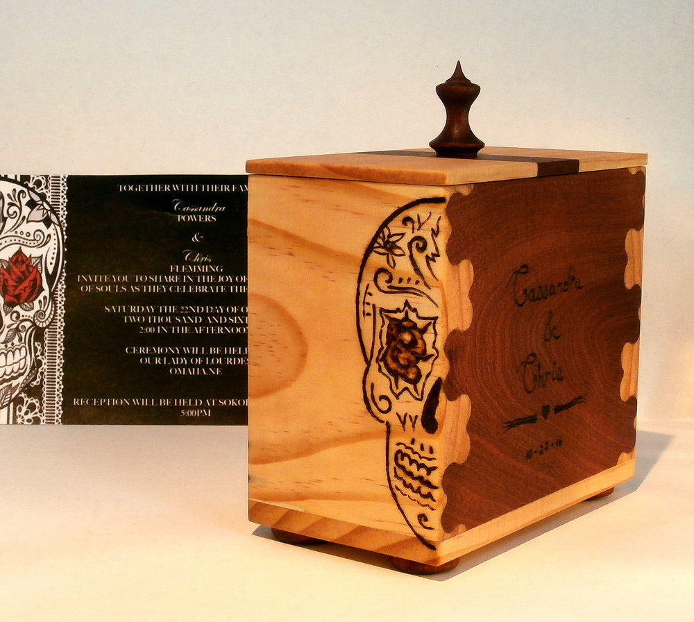 Mahogany and pine box with heart shaped dovetail joints. Wood burnt inscription and Dia de Los Muertos skull decoration to match wedding invitation.