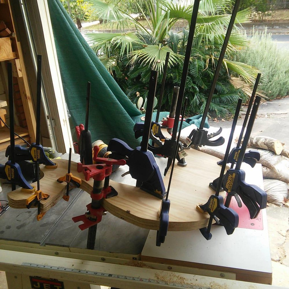 Making of the rocking dinosaur requires a lot of clamps.