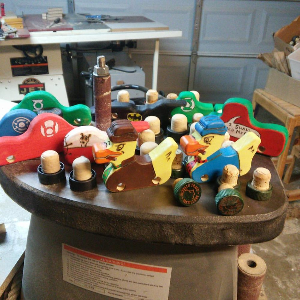Our wooden toys got pretty weird this holiday season with aliens, Howard the Ducks, all colors of the Lantern Core, Batman and more!