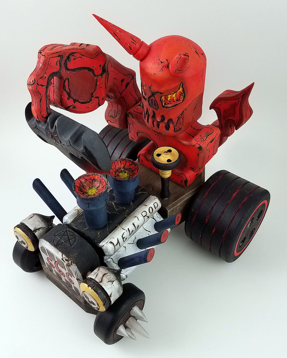 Our love of Ed Roth's Rat Fink and hot rods came to life in this little devil.