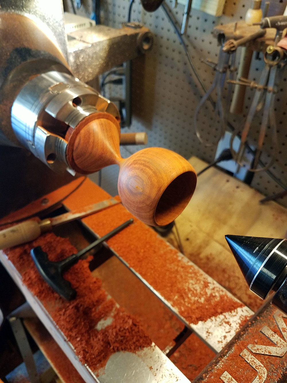 Padauk wood is  a very vibrant orange turning everything in the shop a bright orange, including Terry!