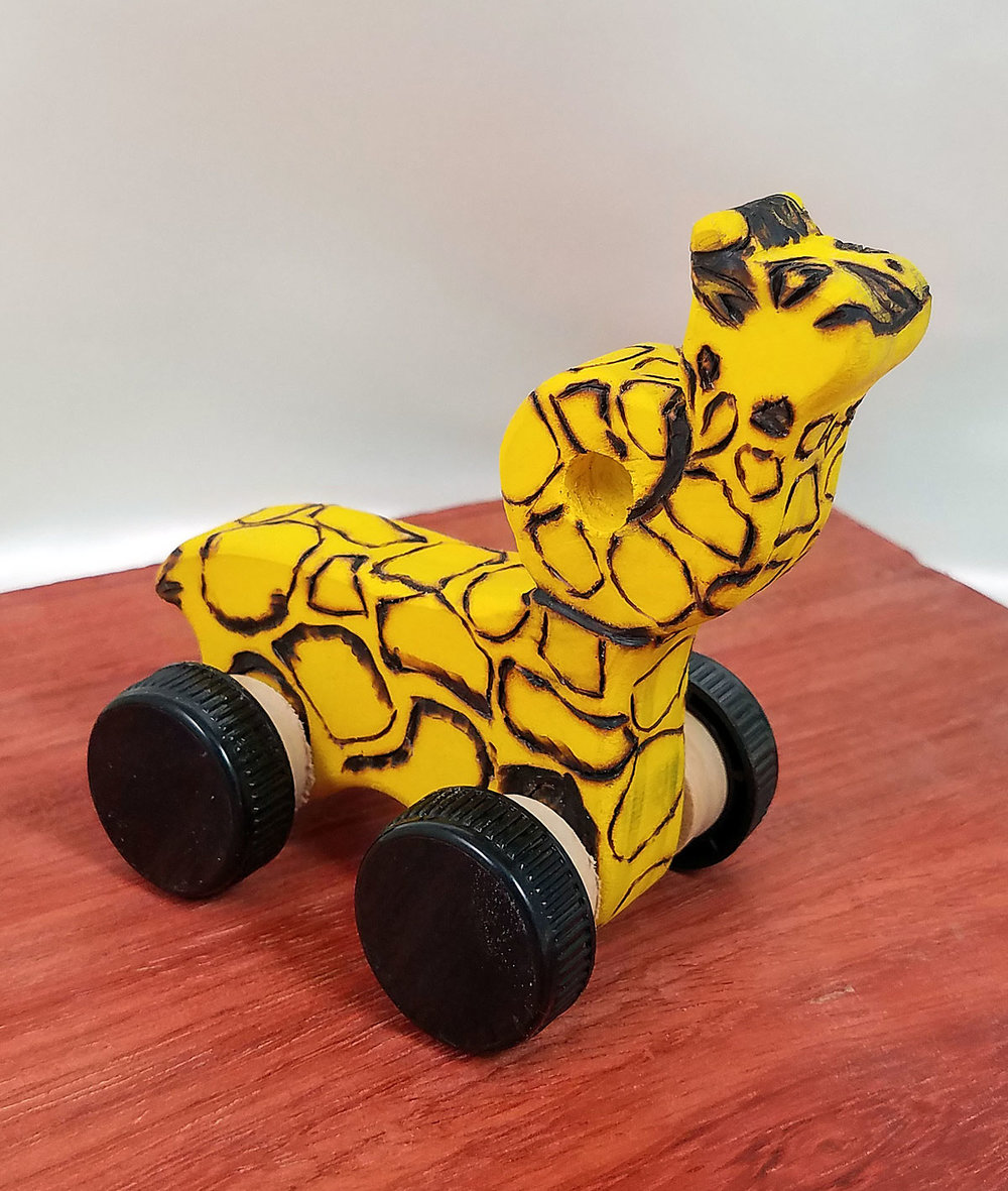 Girrafe cork car made with whisky cork wheels.