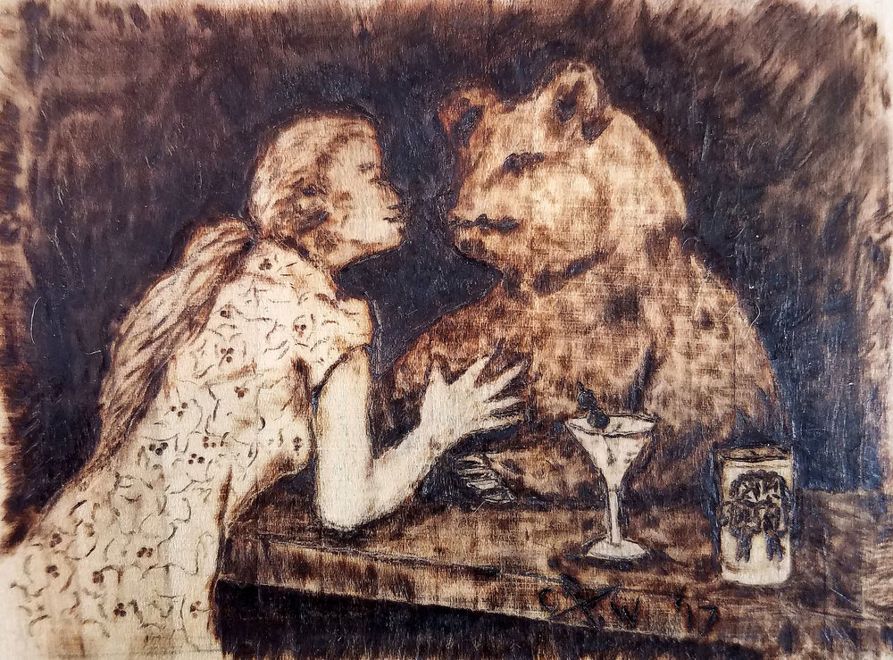 In the wood burning the woman and the bear kiss over the bar with a martini and a Pabst Blue Ribbon beer can.