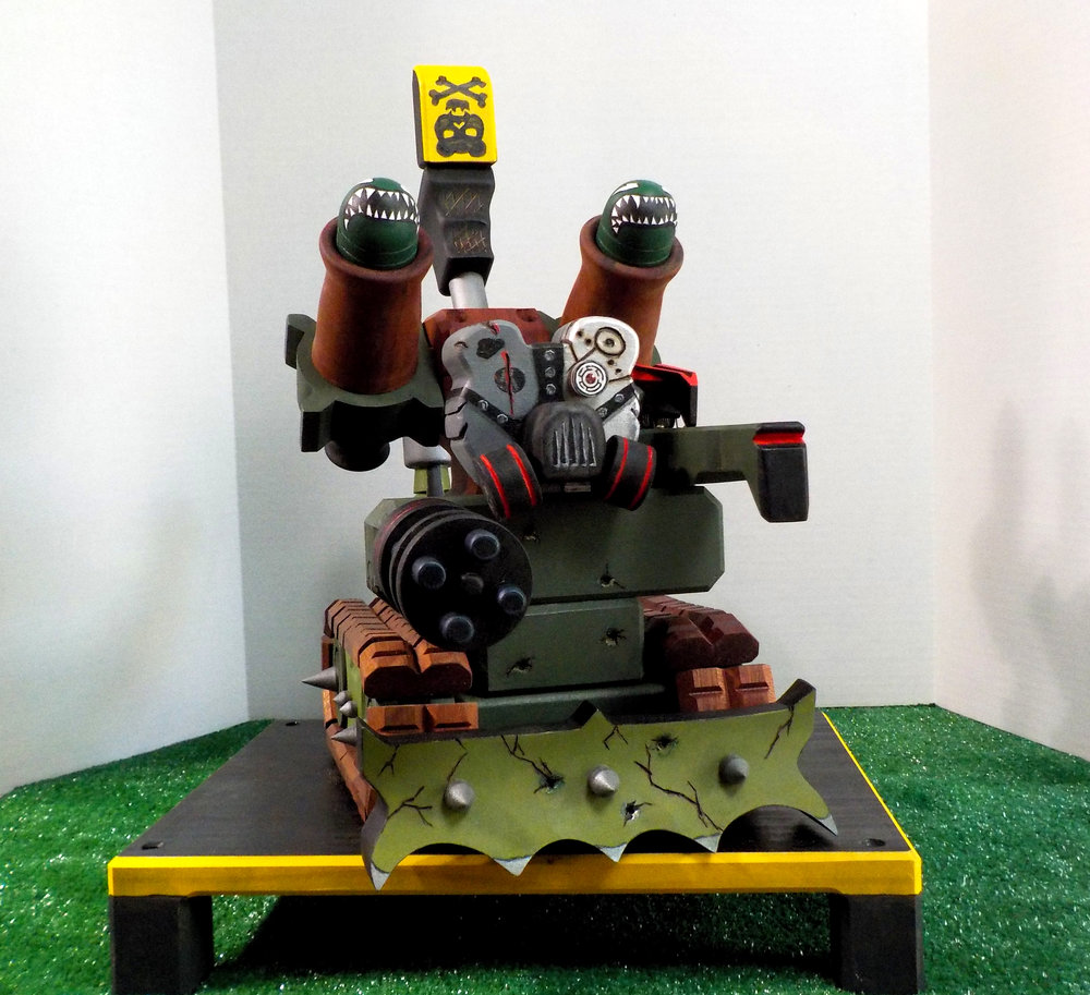 This is  Death Crusher . He's made of hand painted poplar and oiled mahogany. Shooting cannons, rubber band gun, rotating turret and moving tank tracks. Much more than your everyday toy!