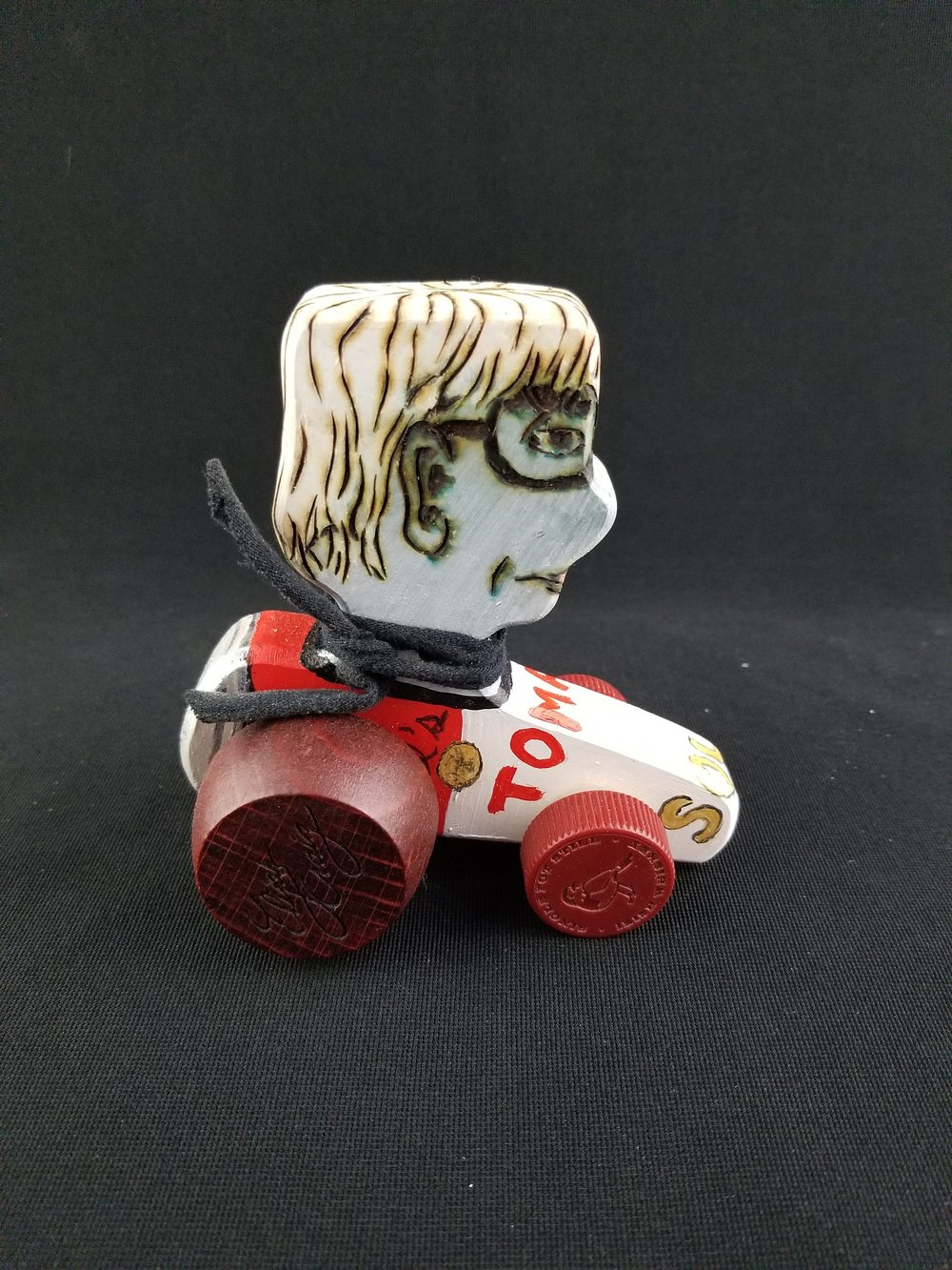 We use recycled champagne and liquor corks to make cork cars. Lately the creations have verged on miniature art and not quite for the kids. In case you don't recognize him right away this one is Andy Warhol riding a Campbell's soup can.