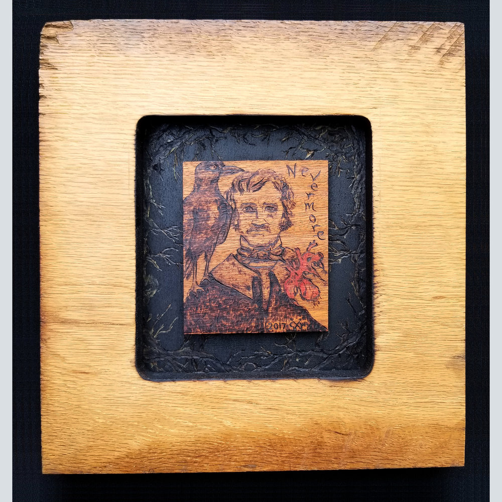 Edgar Allen Poe portrait with raven and a human heart offering in a handmade frame.