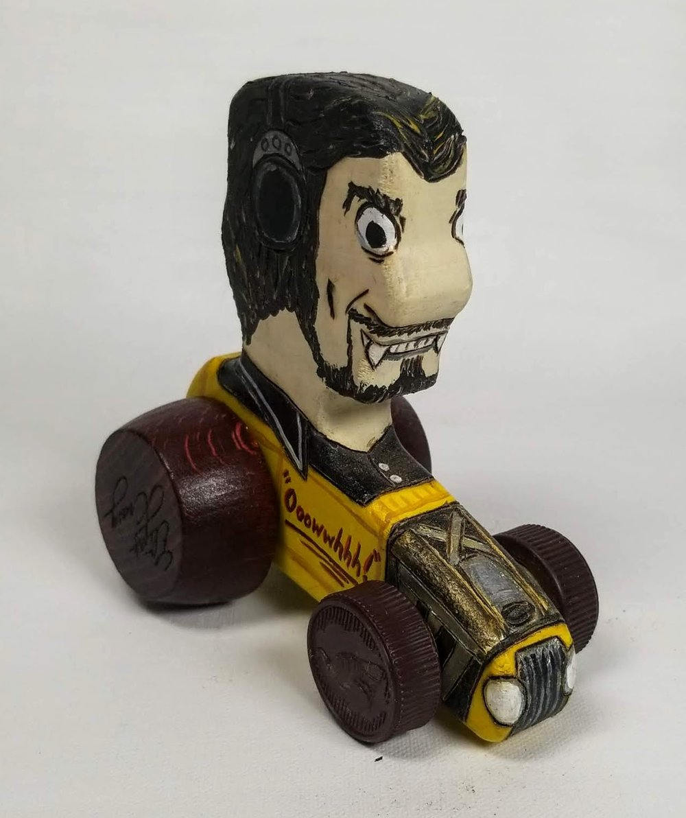 Sculpture toy of disc Jokey and star of American Graffiti, Wolfman Jack.