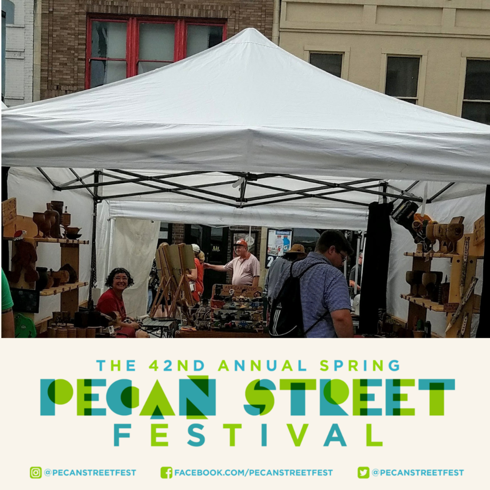 42nd annual Spring Pecan Street Festival, artists tents and lots of people.
