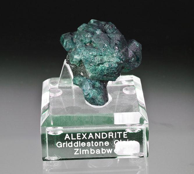 Color change alexandrite from Zimbabwe, 4.2 x 4.1 x 2.9 cm, from the Girdlestone Farm locality in the southeastern province of Masvingo.
