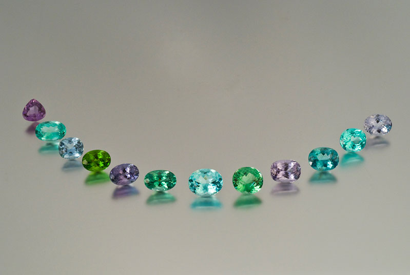 A suite of copper-bearing Mozambique tourmalines from Pala International. Twelve pieces, 30.66 carats.