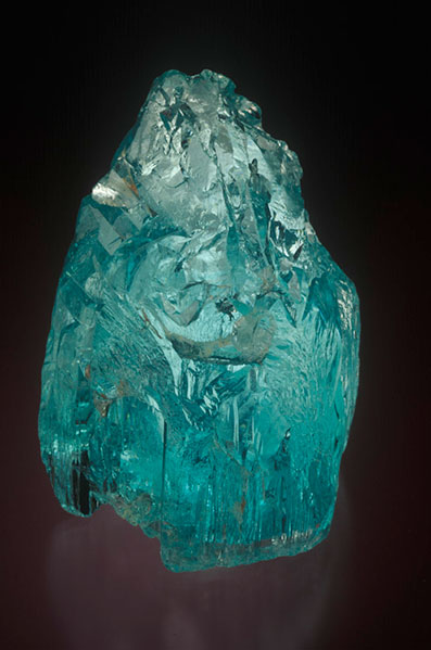 Natural crystal of gem quality aquamarine from Mozambique. Old H Bank specimen now in the William Larson Collection.