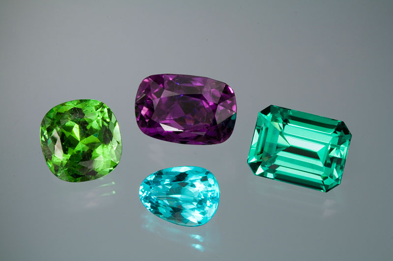 More copper-bearing Mozambique tourmalines from Pala International. The amethyst color cushion is 15+ carats and would heat to fine Paraiba blue.