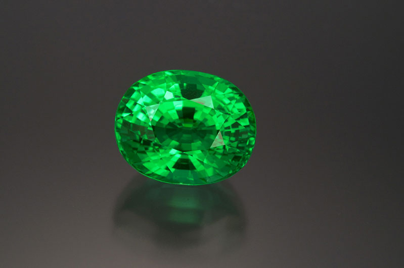Rare copper tourmaline, 15+ carats, natural-color greenish Paraiba.