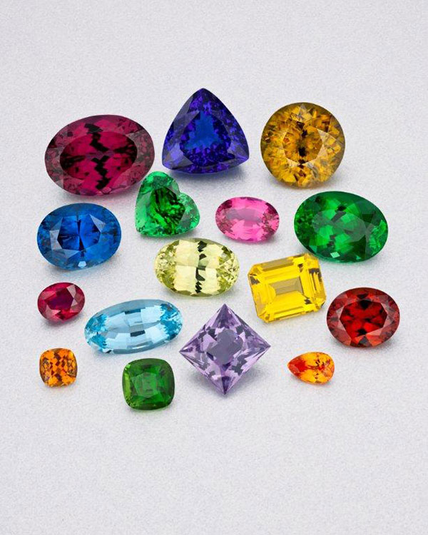 The gemstones of East Africa are courtesy of Bridges Tsavorite, Evan Caplan, Intercolor USA, and RareSource. From top, left to right: Rhodolite garnet, 44.36 carats from Kenya (Caplan); tanzanite, 29.20 carats from Tanzania (Intercolor); sphene, 25.03 carats from Madagascar (RareSource); sapphire, 22.12 carats from Madagascar (Caplan); tsavorite garnet, 10.64 carats from Kenya (Bridges Tsavorite); pink spinel 5.26 carats from Tanzania (Caplan); green cuprian tourmaline 17.84 carats from Mozambique (Raresource); ruby, 4.05 carats from Mozambique (Caplan); chrysoberyl 12.77 carats from Tanzania (RareSource); canary tourmaline, 12.45 carats from Zambia (RareSource); malaia garnet, 16.70 carats from Tanzania (RareSource); golden tourmaline, 2.28 carats from Kenya (Bridges Tsavorite); chrome tourmaline, 5.27 carats from Tanzania (RareSource); lavender spinel, 13.18 carats from Tanzania (RareSource); and spessartite garnet, 2.09 carats from Kenya (Bridges Tsavorite). (Photo: Robert Weldon, © GIA 2012)