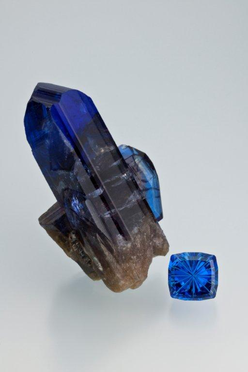 Tanzanite, one of East Africa's most notable gems, is a form of the mineral zoisite. Discovered in 1967, it is only found in Tanzania. Tanzanite crystal specimen courtesy of Evan Caplan, and the faceted tanzanite, 10.22 carats is courtesy of John Dyer & Co. (Photo: Robert Weldon, © GIA 2012)