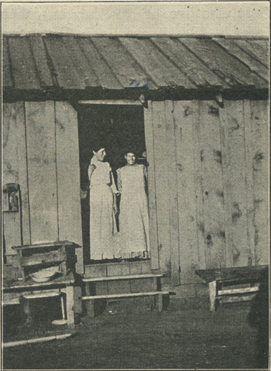 Mountain girls at cabin door