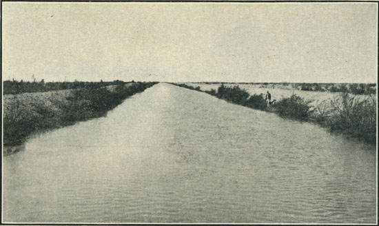 An irrigation canal, San Diego County; canals like these make fertile thousands of hitherto uncultivated acres. (Photo: Putnam & Valentine)