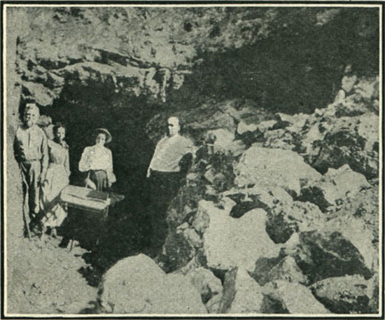 Where topaz and tourmaline are mined. (The writer of the accompanying article is at the tunnel entrance.)