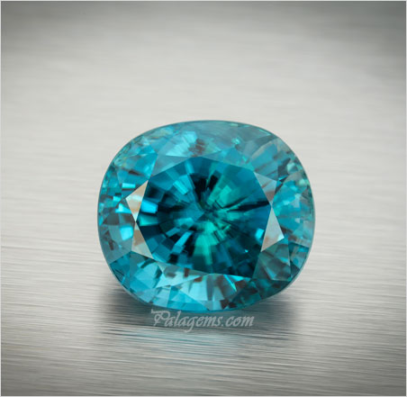 Wonderful large, clean blue cushion-cut zircon from Cambodia, 36.11 ct, 17.89 x 15.89 x 12.69 mm. Inventory #22357. (Photo: Mia Dixon)