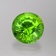 Pinch insurance.  A natural bright green peridot from Burma, 12.93 carats, Inventory  #4994 . (Photo: Mia Dixon)