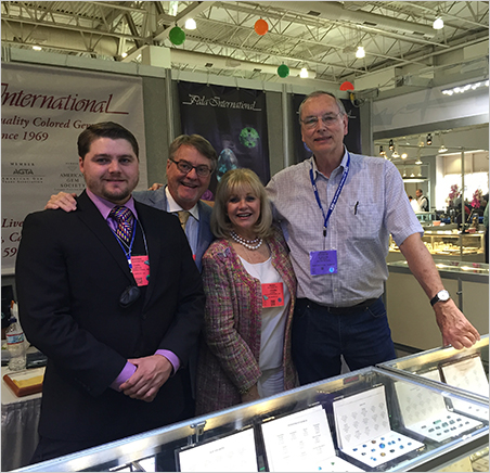 3 + 1. Pala International's Carl, Bill and Jeanne Larson at the AGTA GemFair with Julius Petsch, a famous dealer from Idar-Oberstein, Germany.