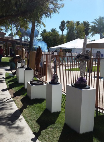 Balancing act.   Mineral sculptures line a walkway leading to the barbecue pavilion at the Arizona Mineral & Fossil Show. (Photos: Mia Dixon)