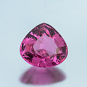Saucy spinel. A natural reddish pink spinel from Mogok, 2.45 carats, Inventory #1733. (Photo: Mia Dixon