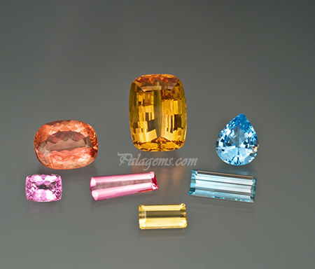 Topaz suite: Pink cushion 4.97 ct, imperial cushion 22.49 ct, rose tapered emerald cut 4.76 ct, golden cushion 53.80 ct, yellow emerald cut 4.11 ct, light blue emerald cut 9.76 ct, blue pear shape 10.74 ct. (Photo: Mia Dixon)
