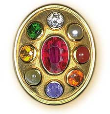 A fine modern example of a   navaratna   jewel, based on Indian planetary gemology. The gems are clockwise from the top, diamond, pearl, coral, hessonite garnet, sapphire, cat's eye, yellow sapphire, emerald and ruby (center). Jewel and photo courtesy of    Richard Brown   ,    Astral Gemstones and Talismans   , Bangkok, Thailand.