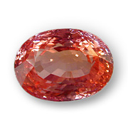 The above stone is a fine example of a padparadscha sapphire. It features the delicate pinkish orange color that resembles the color of a lotus flower. (Photo: Wimon Manorotkul; Gem: Pala International)