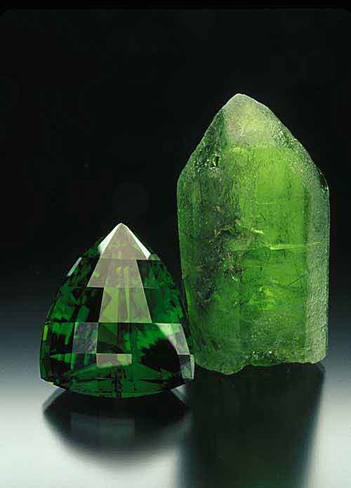 Two magnificent examples of peridot. The cut stone at left is an incredible 172.53 cts. Thee crystal at right is equally rare. Both are from Pakistan. Stone: Pala International; crystal: William Larson collection. (Photo: Jeff Scovil)