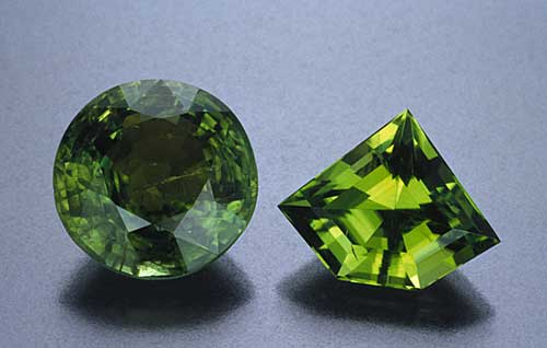 Two different peridots, illustrating the importance of clarity. The stone at left is heavily included, while that at right has far better clarity. (Photo: Robert Weldon)