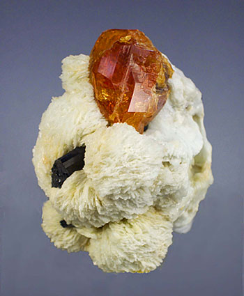 Spessartite with schorl tourmaline and clevelandite from the Little Three mine at Ramona, San Diego County, California. (Photo: Wimon Manorotkul)