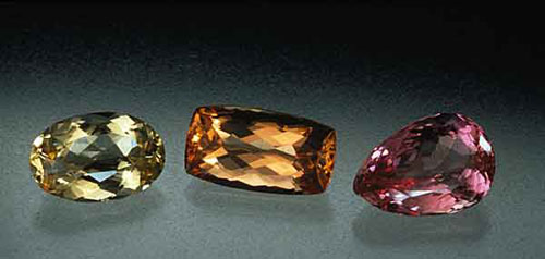 Three different flavors of imperial topaz from Brazil. 4.8 cm. high. The most highly sought would be the pink gem at right. Gems: Pala International. (Photo: Robert Weldon)