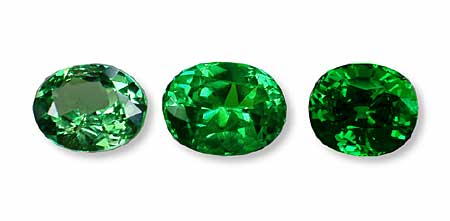 This suite of tsavorites shows the typical range of colors possible. The ideal would be the center stone, which is not too light or dark. (Photo: Wimon Manorotkul; Gem: Pala International)