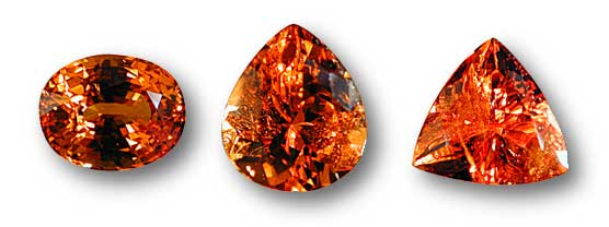 Different levels of clarity are visible here in these spessartine garnets from Nigeria. The oval stone at left is eye clean, i.e., with no clarity defects visible to the unaided eye. In the pear-shaped middle stone, obvious clarity defects are visible, while in the trillion-shaped stone at right, they are even more obvious. Photos: Wimon Manorotkul