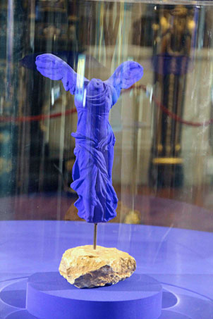 Clothed.  Sorry to disappoint, but this is not one of Yves Klein's naked paintbrushes.  Victoire de Samothrace  (1962 IKB pigment and resin on plaster, edition of 175) is Klein's homage to the famous Hellenistic original that stands on a landing of the Louvre's Daru staircase. (Photo: S. Tavernier)