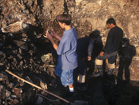 Finders keepers?  Will Larson, left, in 1997 at the Karkodino Mine. He was finding demantoid garnets alongside Russian miners. (Photo: Bill Larson)