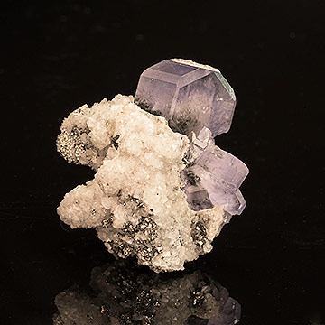 Fluorapatite  on calcite with a dusting of pyrite. From Portugal, Inv.  #21482 . (Photo: Mia Dixon)