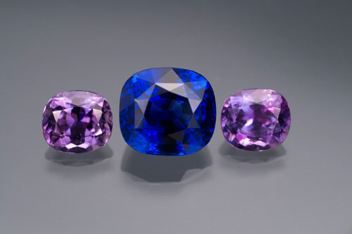 A 7-carat natural Ceylon sapphire flanked by two cuprian tourmalines