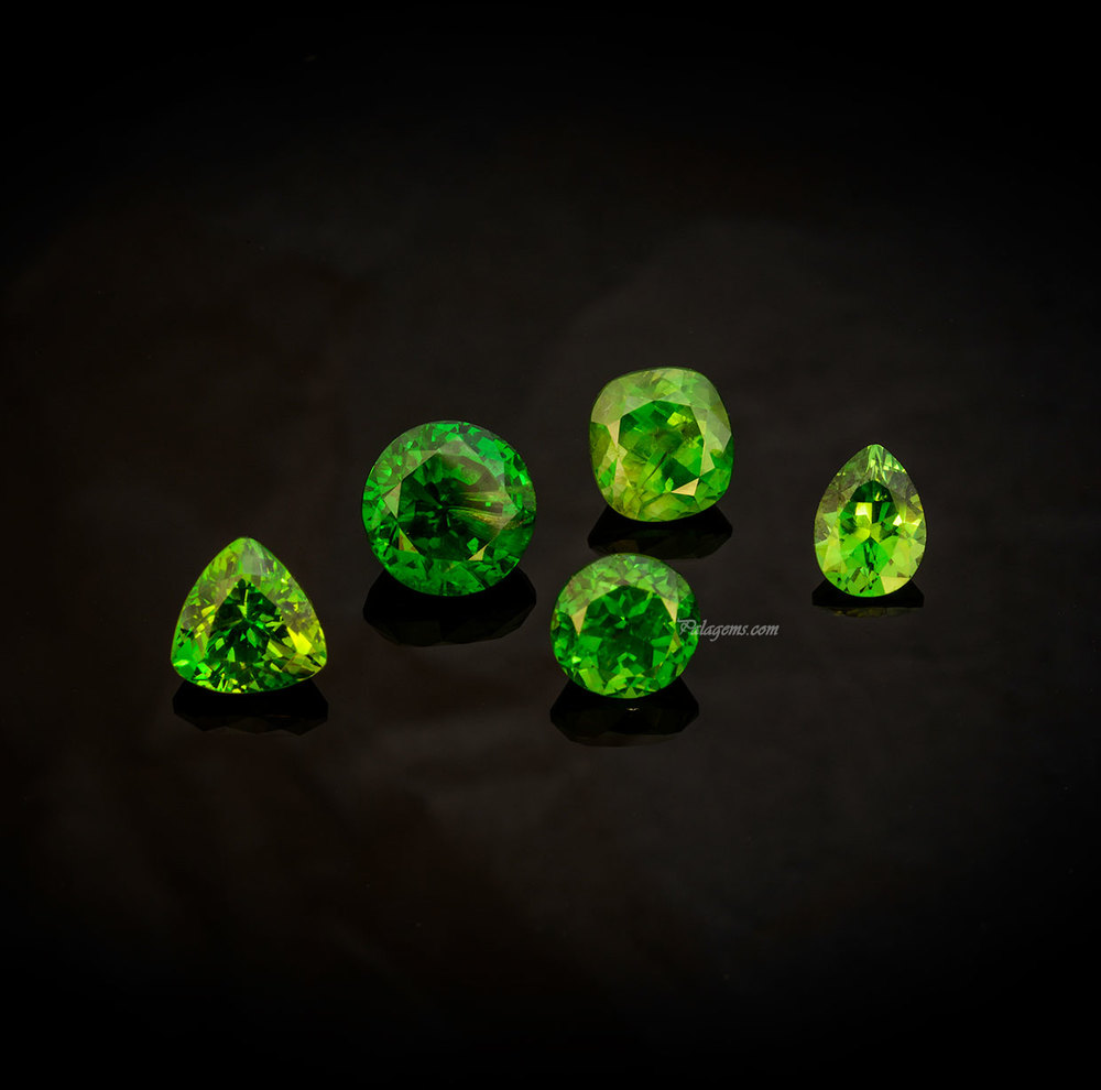 Russian quintette. From back left, 1.56-ct trillion, 2.57-ct round, 1.72-ct cushion, 0.76-ct pear shape, and in front a 1.63-ct round. Click image to enlarge. (Photo: Mia Dixon)