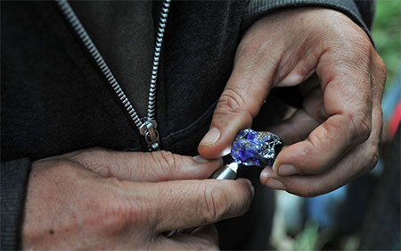 "Madagascar has multiple gemstone-producing localities. Above, a large blue sapphire seen in Didy, from our December 2012 newsletter item ""Giddy in Didy – Part Two."" (Photo by Vincent Pardieu. © GIA)"