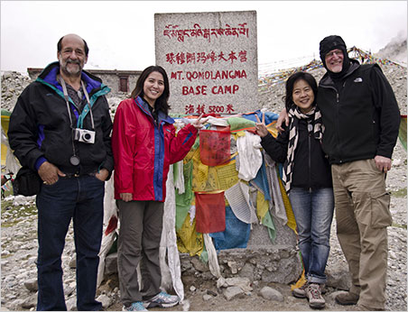 Dana Schorr, Billie Hughes, Wimon Manorotkul and Richard Hughes stand at the base camp of Mt. Everest (Mt. Qomolangma) in the mid-summer of 2011 at 17,000 feet. (Photo courtesy Richard W. Hughes, from this article)