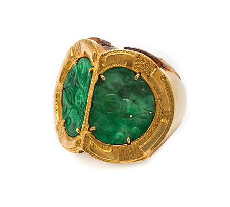 Lot 240 is a ring by David Webb from the Hassenfeld collection. It features two semicircular pierced jadeite plaques (17.47 x 12.71 mm) that appear to be carved in the form of stylized butterflies. (Photo courtesy Leslie Hindman Auctioneers)