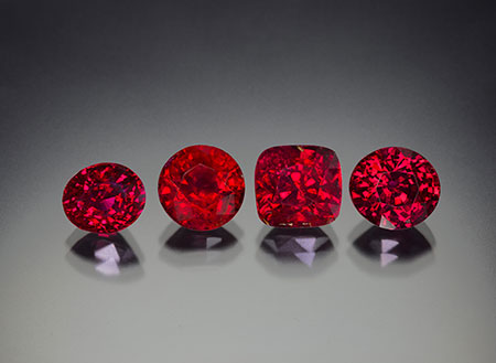 "Four untreated rubies from the new find in Madagascar, ranging in size from 4.0 to 6.5 ct. As can be seen, the new production is extremely gemmy. Most gems fell into the Lotus Gemology proprietary ""Royal Red"" color type. (Photo: Wimon Manorotkul/Lotus Gemology)"