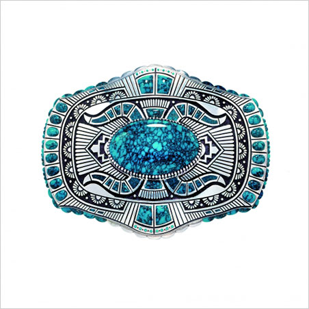 Belt Buckle. Lee A. Yazzie, 2000. Lone Mountain turquoise, sterling silver. Length, 2 3/8 in. Collection of Gene and Ann Waddell. (Photo: © Kiyoshi Togashi)