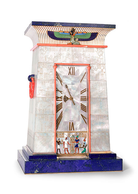 Striking. Egyptian striking clock owned by Florence Meyer Blumenthal (1875–1930), wife of German banker George Blumenthal. She was a patron of the arts whose philanthropy included the Prix Blumenthal, awarded to two hundred recipients in arts and letters between 1919 and 1954. This clock, 24 x 15.7 x 12.7 cm, was created in 1927, using gold, silver gilt, mother of pearl, lapis lazuli, coral, emerald, carnelian, and enamel. Cartier Collection. Click for hi-res. (Photo: Nick Welsh, Cartier Collection © Cartier)