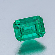 Enhanced. A nice 1.11-carat Colombian emerald, treated with oil and resin. Inventory #20793. (Photo: Mia Dixon)