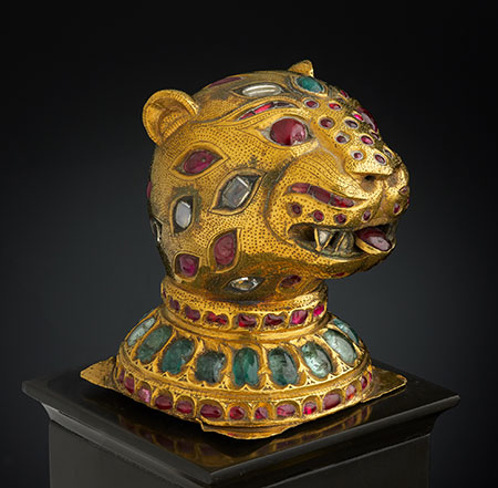 Finial from the Throne of Tipu Sultan , South India, Mysore, ca. 1790. Gold, inlaid with diamonds, rubies, and emeralds; lac core. H. 2-3/4 in. (6.8 cm), W. 2-1/8 in. (5.4 cm), D 2-1/4 in. (5.5 cm). Al-Thani Collection. (Photo: © Prudence Cuming Associates)